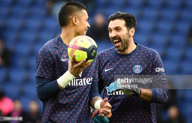 Paris SaintGermain's Italian goalkeeper Gianluigi Buffon jokes with Paris SaintGermain's French goalkeeper Alphonse Areola ahead of the French L1...