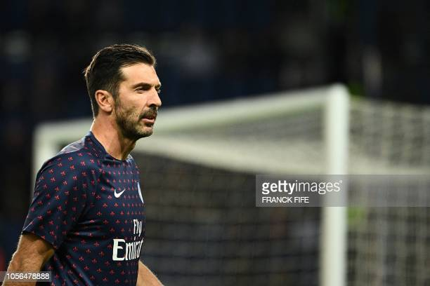 Paris SaintGermain's Italian goalkeeper Gianluigi Buffon looks on during the warm up session prior to the French L1 football match between Paris...