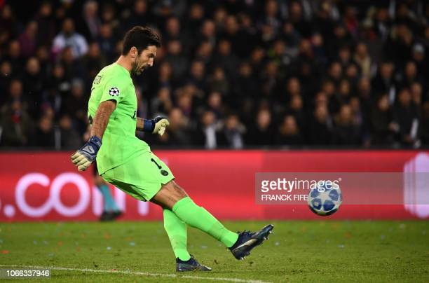 Paris SaintGermain's Italian goalkeeper Gianluigi Buffon plays the ball during the UEFA Champions League Group C football match between Paris...