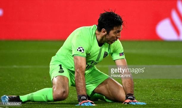 Paris SaintGermain's Italian goalkeeper Gianluigi Buffon reacts after he failed to catch the ball during the UEFA Champions League round of 16...