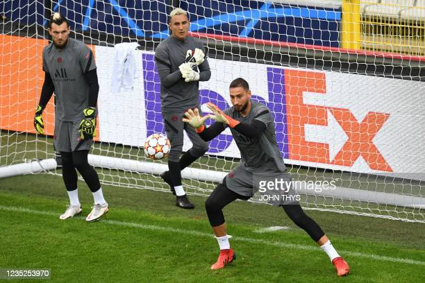 Paris Saint-Germain's Italian goalkeeper Gianluigi Donnarumma grabs a ball past Paris Saint-Germain's Costa Rican goalkeeper Keylor Navas and Paris...
