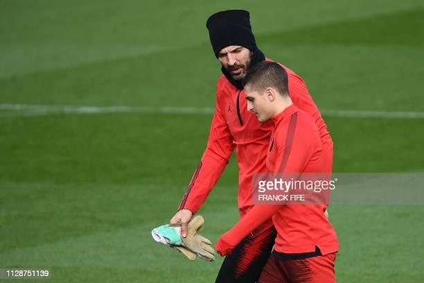 Paris SaintGermain's Italian midfielder Marco Verratti and Paris SaintGermain's Italian goalkeeper Gianluigi Buffon arrive for a training session at...