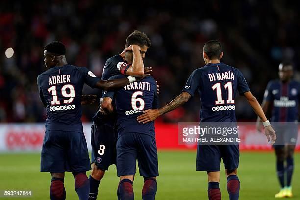 Paris SaintGermain's Italian midfielder Marco Verratti celebrates with his teammates Ivorian defender Serge Aurier and Argentinian midfielder Angel...