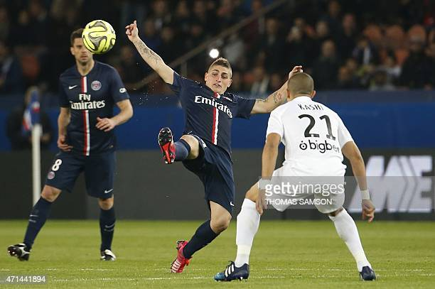 Paris SaintGermain's Italian midfielder Marco Verratti challenges Metz's Algerian midfielder Ahmed Kashi during the French L1 football match between...