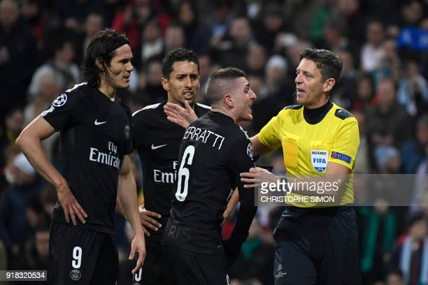 TOPSHOT Paris SaintGermain's Italian midfielder Marco Verratti complains to Italian referee Gianluca Rocchi next to Paris SaintGermain's Uruguayan...