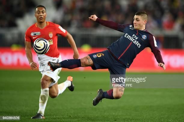 Paris SaintGermain's Italian midfielder Marco Verratti controls the ball as Monaco's Belgian midfielder Youri Tielemans looks on during the French...