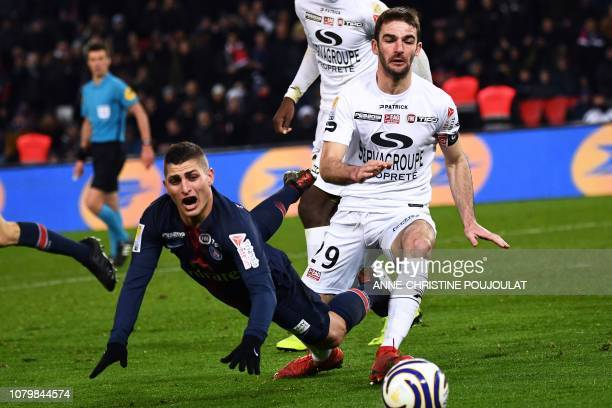 Paris SaintGermain's Italian midfielder Marco Verratti falls next to Guingamp's French defender Christophe Kerbrat during the French League Cup...