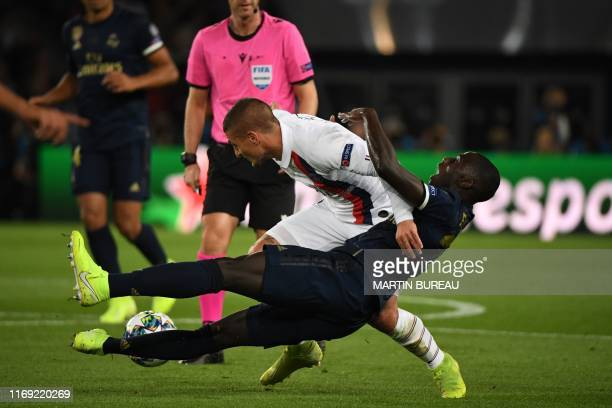 Paris SaintGermain's Italian midfielder Marco Verratti fights for the ball Real Madrid's French defender Ferland Mendy with during the UEFA Champions...