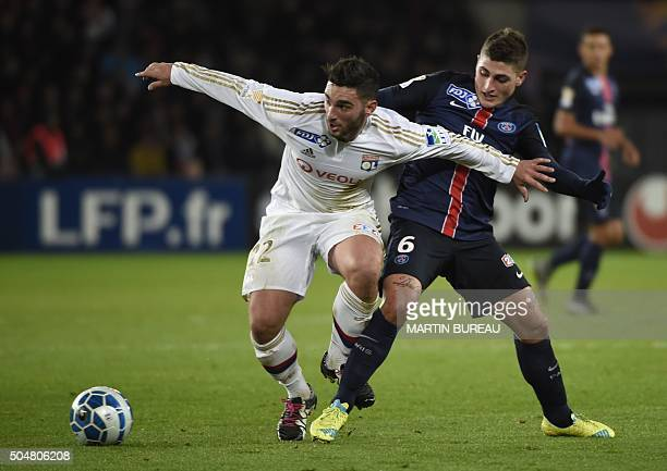 Paris SaintGermain's Italian midfielder Marco Verratti fights for the ball with Lyon's French midfielder Jordan Ferri on January 13 2016 at the Parc...