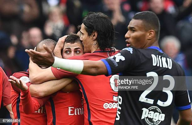 Paris SaintGermain's Italian midfielder Marco Verratti is congratuled by teammates after scoring a goal as Bastia's French defender Alexander Djiku...