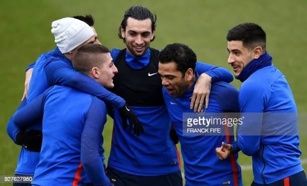 Paris SaintGermain's Italian midfielder Marco Verratti jokes with Paris SaintGermain's Argentinian forward Angel Di Maria Paris SaintGermain's...