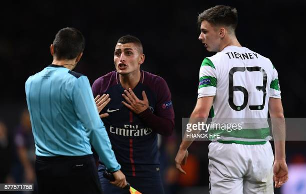 Paris SaintGermain's Italian midfielder Marco Verratti reacts as a linesman speaks to him while Celtic's Scottish defender Kieran Tierney looks on...