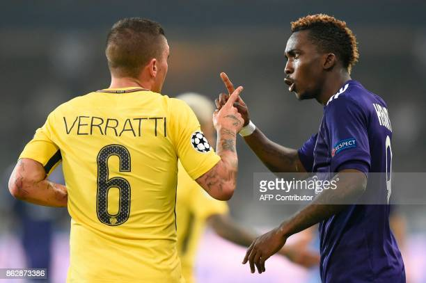 Paris SaintGermain's Italian midfielder Marco Verratti reacts with Anderlecht's Nigerian forward Henry Onyekuru during the UEFA Champions League...