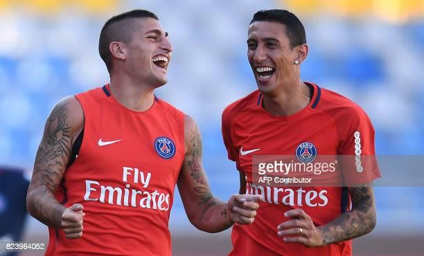 Paris SaintGermain's Italian midfielder Marco Verratti shares a laugh with Paris SaintGermain's Argentinian forward Angel Di Maria during a training...