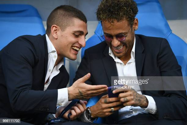 TOPSHOT Paris SaintGermain's Italian midfielder Marco Verratti shares a laugh with Paris SaintGermain's Brazilian forward Neymar Jr ahead of the...