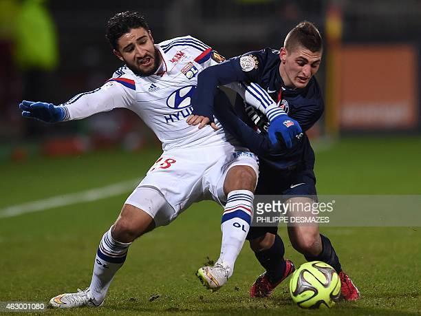Paris SaintGermain's Italian midfielder Marco Verratti vies with Lyon's French forward Nabil Fekir during the French L1 football match Olympique...