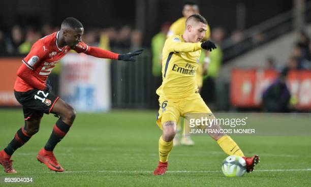 Paris SaintGermain's Italian midfielder Marco Verratti vies with Rennes' French midfielder James Lea Siliki during the French L1 football match...