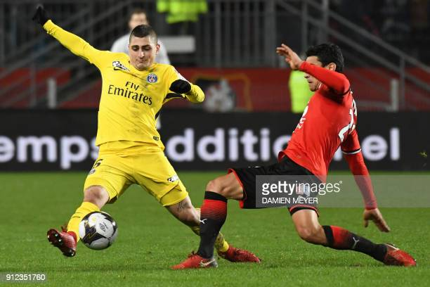 Paris SaintGermain's Italian midfielder Marco Verratti vies with Rennes' French midfielder Benjamin Andre during the French League Cup football...
