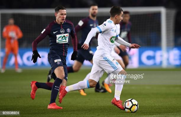 Paris SaintGermain's Italian midfielder Marco Verratti vies with Marseille's French midfielder Maxime Lopez during the French Cup quarterfinal...