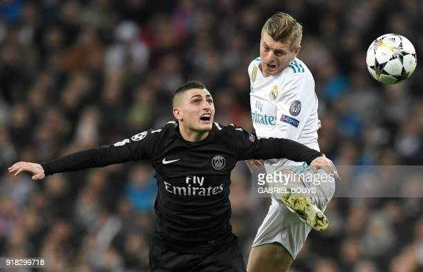 Paris SaintGermain's Italian midfielder Marco Verratti vies with Real Madrid's German midfielder Toni Kroos during the UEFA Champions League round of...