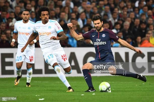 Paris SaintGermain's Italian midfielder Thiago Motta kicks the ball next to Marseille's Brazilian midfielder Luiz Gustavo during the French L1...