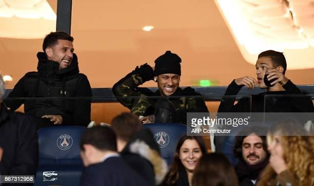 Paris SaintGermain's Italian midfielder Thiago Motta Paris SaintGermain's Brazilian forward Neymar and Paris SaintGermain's French forward Hatem Ben...