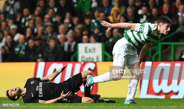 Paris SaintGermain's Italian midfielder Thiago Motta vies with Celtic's Scottish defender Anthony Ralston during the UEFA Champions League Group B...