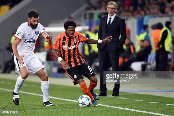 Paris SaintGermain's Italian midfielder Thiago Motta vies with Shakhtar Donetsk's Brazilian midfielder Fred during the UEFA Champions League group A...