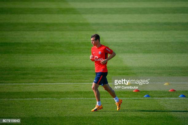Paris SaintGermain's ItalianArgentine midfielder Giovani Lo Celso takes part in a training session at the Oredoo training Centre in...