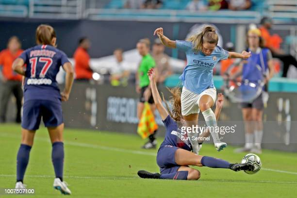 Paris SaintGermain's Jordyn Huitema slides to kick the ball away from Manchester City's Abbie McManus during the third place game of the...