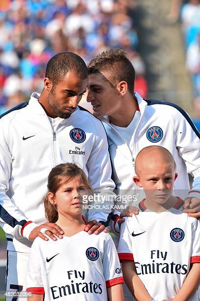 Paris SaintGermain's Marco Verratti and Lucas Moura chat before an International Champions Cup football match against Chelsea in Charlotte North...