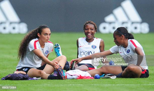 Paris SaintGermain's MarieAntoinette Katoto shares a joke with teammates Cristiane and Perle Morroni during the UEFA Women's Champions League Final...