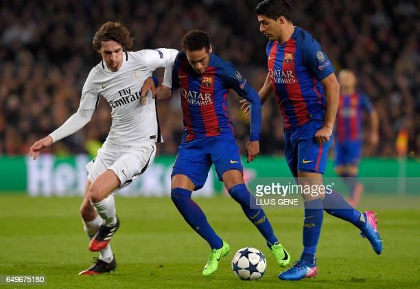 Paris SaintGermain's midfielder Adrien Rabiot vies with Barcelona's Brazilian forward Neymar and Barcelona's Uruguayan forward Luis Suarez during the...