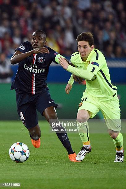 Paris Saint-Germain's midfielder Blaise Matuidi vies with Barcelona's Argentinian forward Lionel Messi during the UEFA Champions league quarter-final...