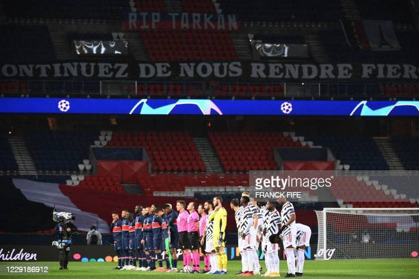Paris SaintGermain's players and Manchester United's players line up in an empty stadium prior to the UEFA Champions League Group H firstleg football...