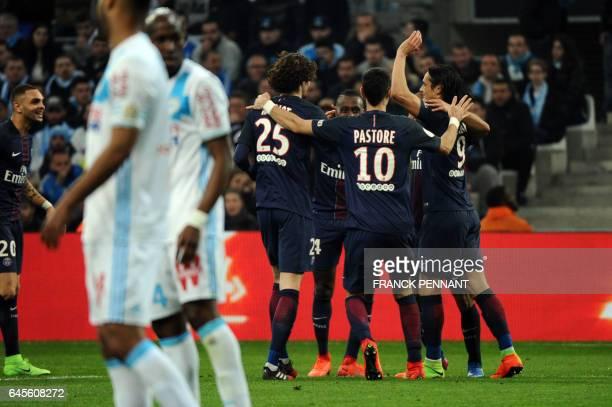 Paris Saint-Germain's players celebrate after a goal during the French L1 football match Olympique de Marseille vs Paris Saint-Germain on February...