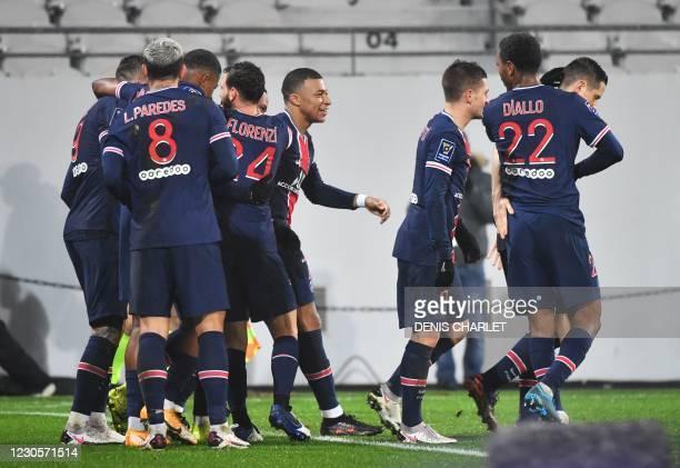 Paris Saint-Germain's players celebrate after Paris Saint-Germain's Brazilian forward Neymar scored a penalty kick during the French Champions Trophy...