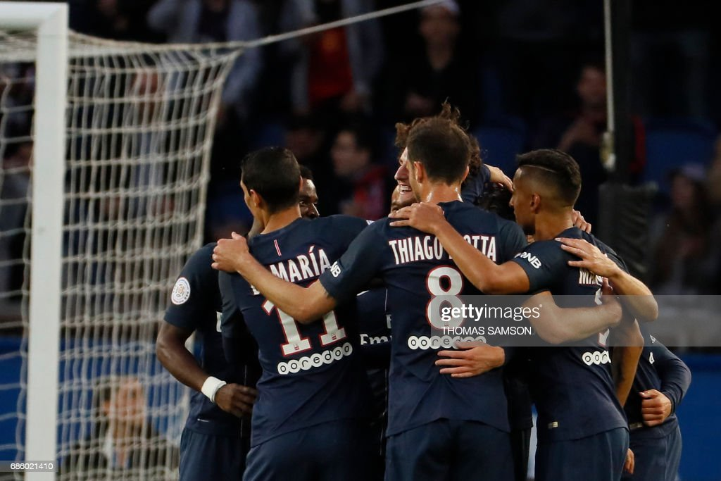Paris Saint-Germain's players celebrate after scoring a goal during the French L1 football match between Paris Saint-Germain (PSG) and SM Caen on May 20, 2017 at the Parc des Princes stadium, in Paris. /