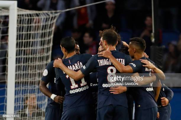 Paris SaintGermain's players celebrate after scoring a goal during the French L1 football match between Paris SaintGermain and SM Caen on May 20 2017...