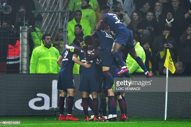 Paris SaintGermain's players celebrate after scoring a goal during the French L1 football match between Nantes and Paris SaintGermain at the La...