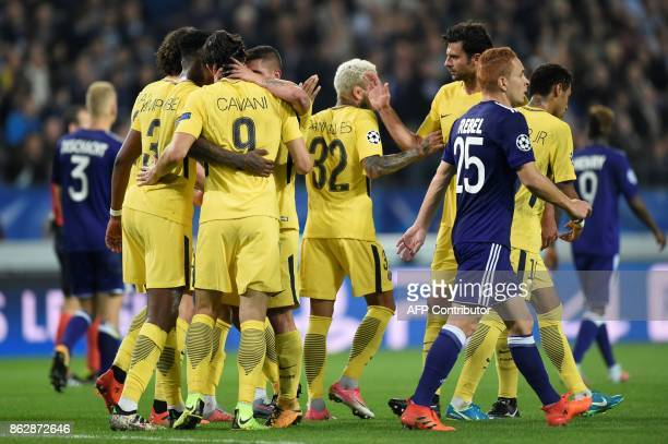 Paris SaintGermain's players celebrate after scoring a goal next to Anderlecht's French midfielder Adrien Trebel during the UEFA Champions League...