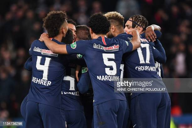 Paris SaintGermain's players celebrate after scoring their first goal during the French Cup semifinal football match between Paris SaintGermain and...