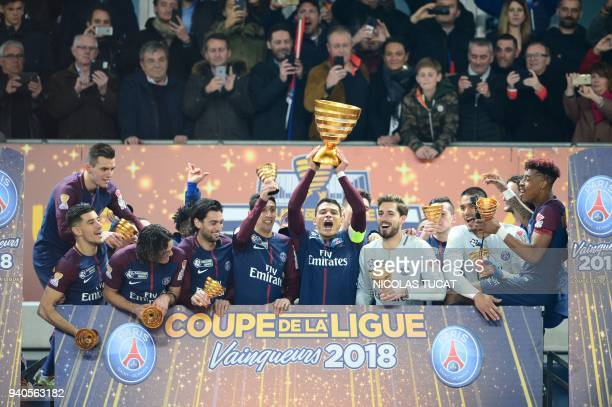 Paris SaintGermain's players celebrate after victory in the French League Cup final football match between Monaco and Paris SaintGermain at The...