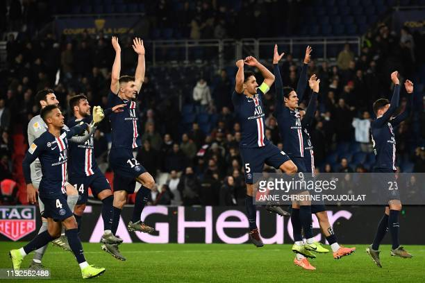 Paris Saint-Germain's players celebrate after winning at the end of the French League cup final quarter match between Paris Saint-Germain and AS...
