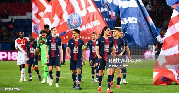 Paris SaintGermain's players celebrate after winning the French L1 football match between Paris SaintGermain and Monaco on April 21 2019 at the Parc...