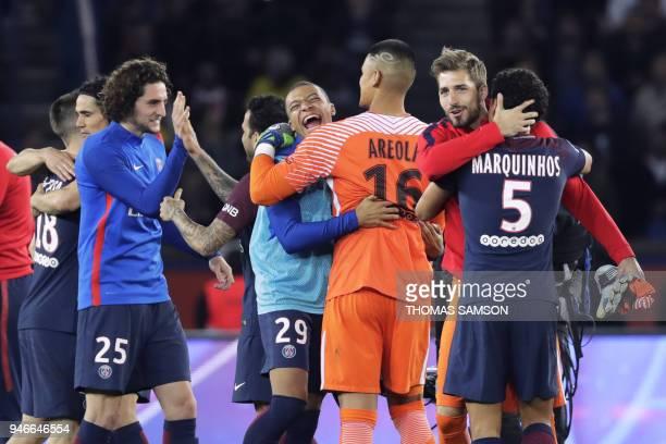 Paris SaintGermain's players celebrate after winning the French L1 football match between Paris SaintGermain and Monaco on April 15 at the Parc des...