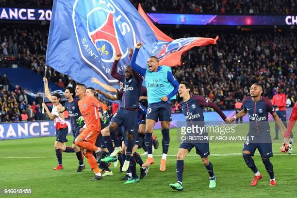 Paris SaintGermain's players celebrate after winning the French L1 football match between Paris SaintGermain and Monaco on April 15 at the Parc des...