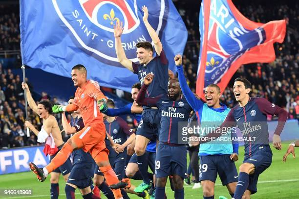 TOPSHOT Paris SaintGermain's players celebrate after winning the French L1 football match between Paris SaintGermain and Monaco on April 15 at the...