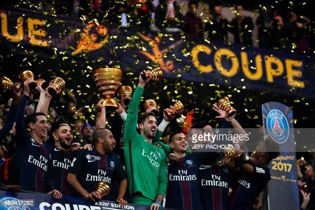 Paris SaintGermain's players celebrate after winning the French League Cup final football match between Paris SaintGermain and Monaco on April 1 at...