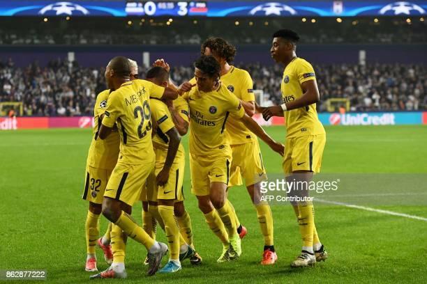 Paris SaintGermain's players celebrate Brazilian forward Neymar after he scored the 30 goal during the UEFA Champions League Group B football match...